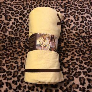 New yellow Sun Bum towel